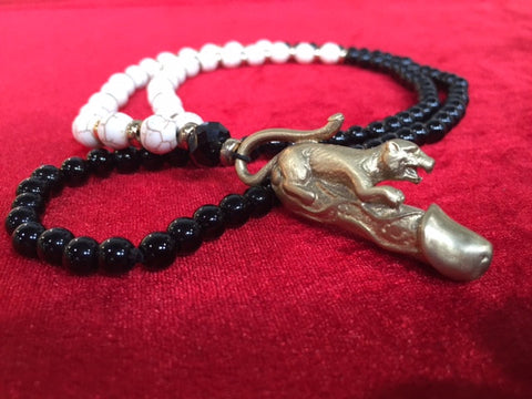 # Necklace penis yellow brass pendant with onyx beads and white howlite