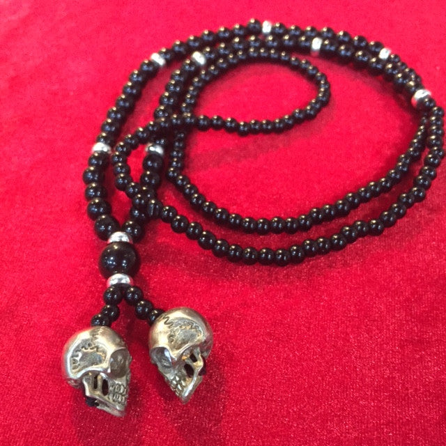 # Necklaces double skull white brass pendant with onyx beads