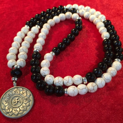 # Necklaces lotus swastika white brass pendant with onyx and white howlite beads