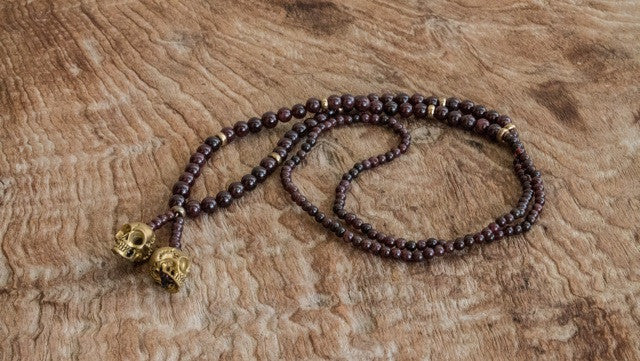 Necklaces double skull yellow brass and red garnet beads NK23