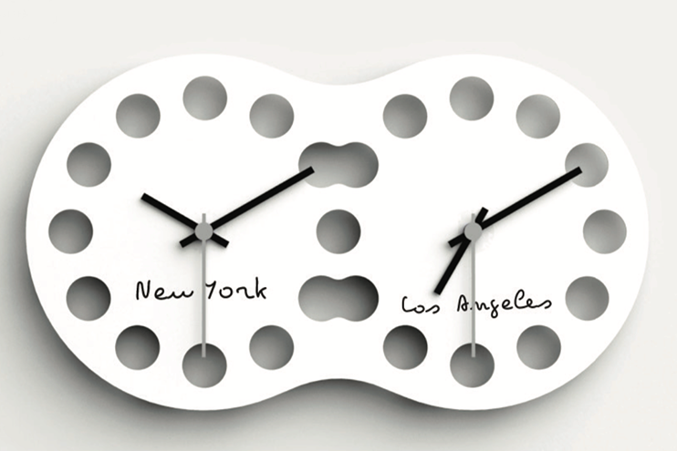 JETLAG  by Alberto Ghirardello.   Jetlag orologio tagliato al laser dotato di due distinti meccanismi che indicano due diversi fusi orari.  Jetlag is a single clock dial laser cut but with two separate mechanisms which indicate two different time zones.