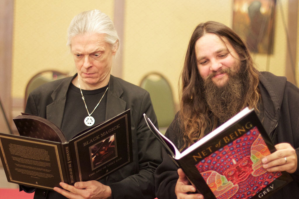 Chet Zar & Alex Grey swapping books. Beinart Publishing