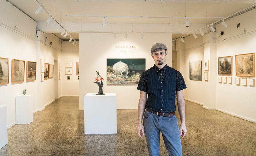 Jon Beinart (Gallery Co-director) during Shaun Tan's solo exhibition, Untold Tales. Photo by Max Milne.