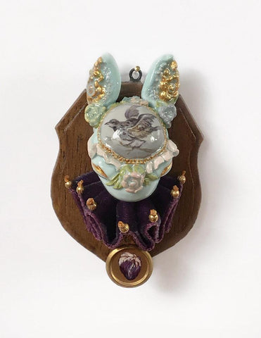 "Miso - ""Purple Martin"" - resin, acrylic and oil paint, brass, velvet fabric and beads - 4.4 x 5.1cm (1.75""x2"")"