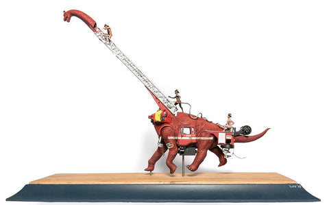 "Stephen Ives - ""The Two Brained Firetruck Myth"" - Mixed media bricolage including wood, plastic model dinosaur and fire truck parts, string, epoxy, polymer clay, glue, wire, sprays and paints - 25 x 85 x 58cm (9.84""x33.5""x22.8"")"