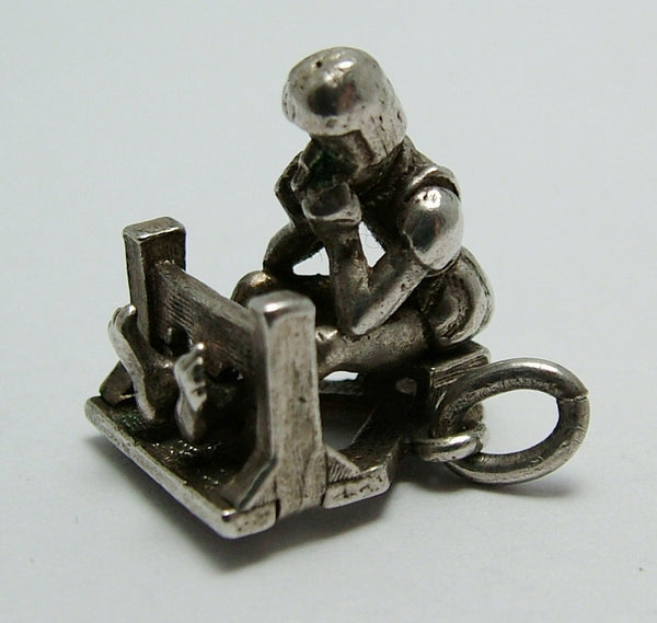 Vintage 1960's Silver Moving Charm of an Elizabethan Man in the Stocks Silver Charm - Sandy's Vintage Charms