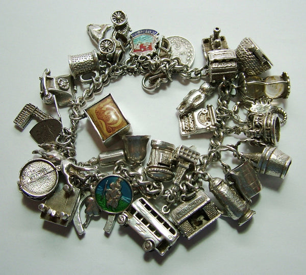 1960's Silver Charm Bracelet complete with 34 Charms including 3 Opening