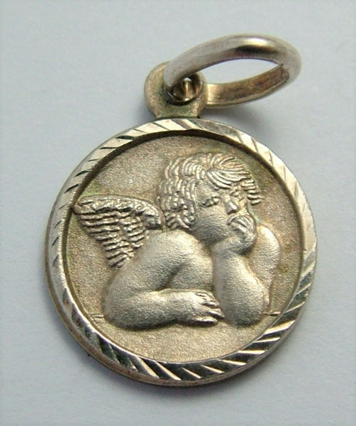 Small Vintage 1980's Silver Raphael Angel Disc Charm