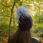 Flossy feather beanie