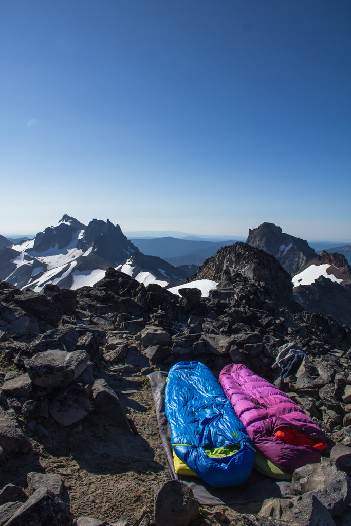 fits sock ambassador cameron evans sleeping bags at top of mountain
