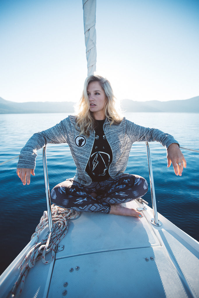 amie engerbretson fits sock ambassador on sailboat