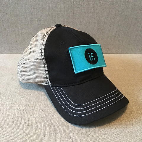 "Black Mesh Back Trucker Hat with signature interchangeable ""IF"" patch"