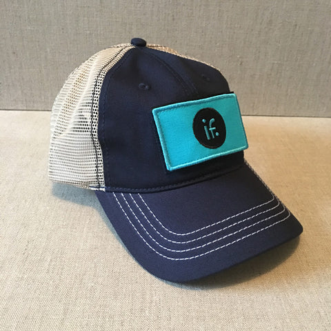 "Navy Mesh Back Trucker Hat with signature interchangeable ""IF"" patch"