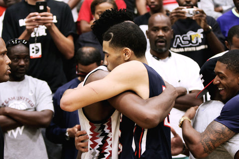 Harry Giles of Team CP3 and Jason Tatum of the St. Louis Eagles (now Brad Beal Elite) embrace after a game between the two that ended on a buzzer-beater during the 2015 Nike Peach Jam Final Four.