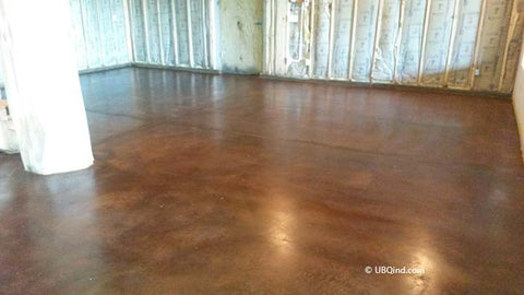 After concrete acid and sealer have been applied to the interior flooring