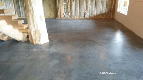 Plain concrete before adding concrete acid stain to the basement floor