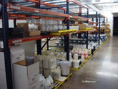 Stocked bottles of concrete acid stain