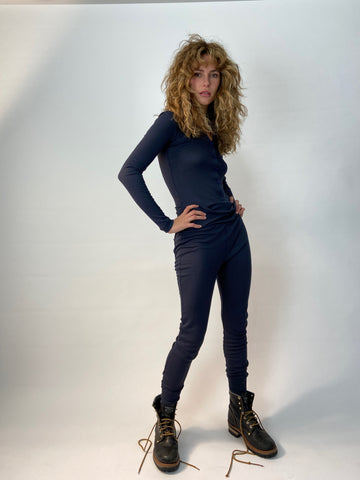 one piece navy ribbed cotton long johns be cool stay warm its all the same! in your navy unitard. Charlie is wearing a size medium for an easy comfy fit.....
