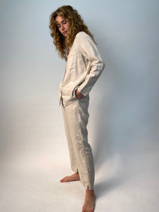 "linen shirt & pant. kaki color shirt has  three pockets and vintage shell buttons. Matching kaki pants have pockets and drawstring waist. The pants are loose fitting with a slight crop above the ankle and 1"" side slit detail at the hem."