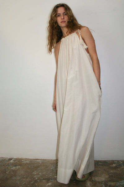 "cotton and silk creme long dress with   adjustable soft cord & tassle shoulder ties   self slip   baby hem details on edge & the ever important   pockets!  EXTRAVAGANT HEM to allow for lengthening or shortening  Made with love in Los Angeles.   CHARLOTTE & FRANCES ARE 5""8"" wearing size medium limited stock"