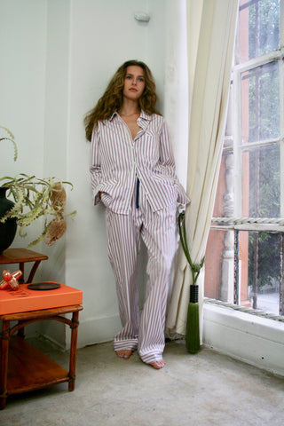"cotton stripe poplin pajama shirt & drawstring pants with pockets finished with silk piping  &  shell buttons  up cycled cotton for sustainability Charlie is wearing a size medium for an oversized fit she's 5'8"" 118lbs limited stock"