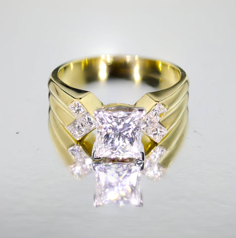 A 2.01-CARAT PRINCESS-CUT DIAMOND RING