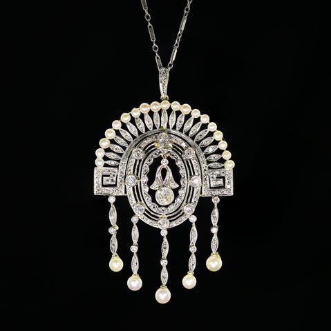 A Bicolor Gold, Diamond and Pearl Pendant and Chain