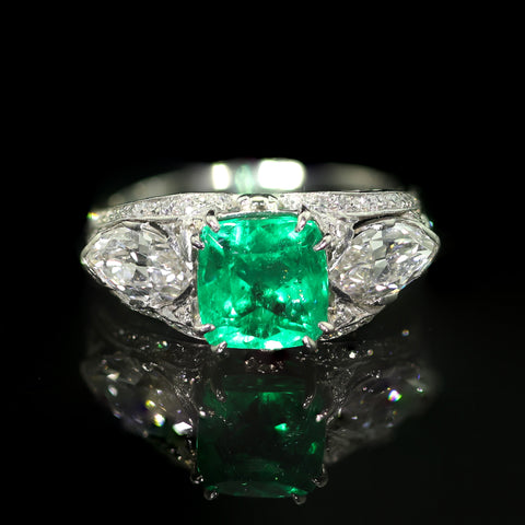 A Platinum, Colombian Emerald and Diamond Ring