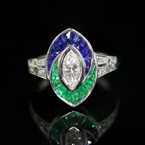 A Diamond Emerald and Sapphire Ring