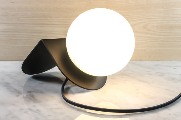 A lamp by Base Modern