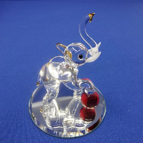 Glass Baron Elephant with Ball Figurine - Ria's Hallmark & Jewelry Boutique