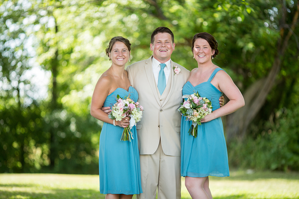 Male bridesman with a tie that matches the bridesmaids