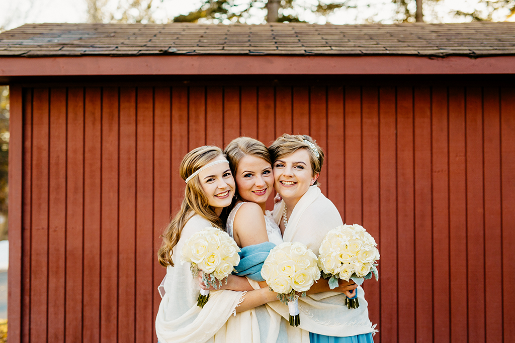 bride-bridesmaids-hugging