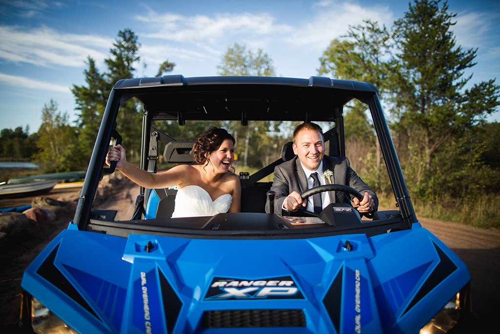 bride and groom in an off-road vehicle