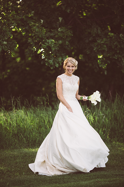 bride twirling in her bridal gown