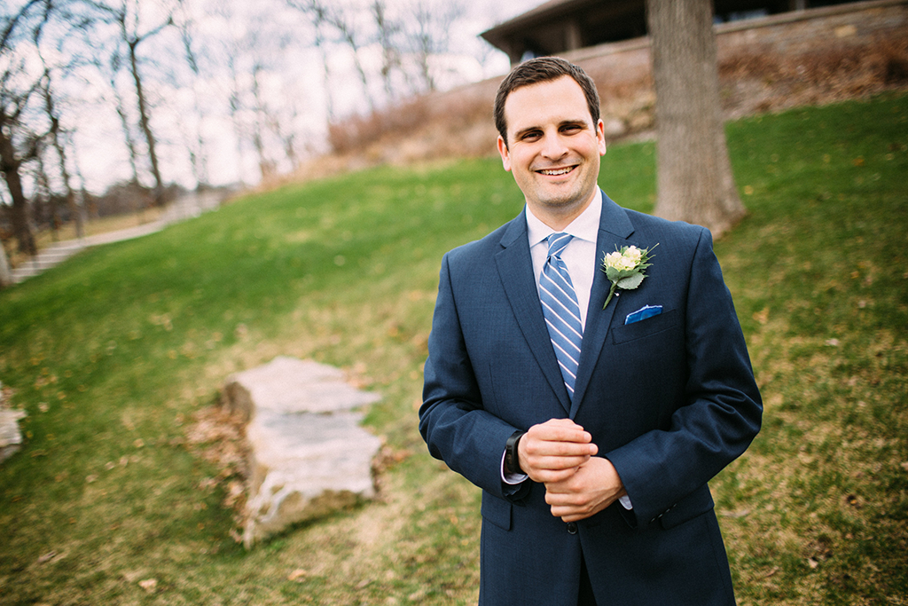 groom with slate blue tie and pocket square