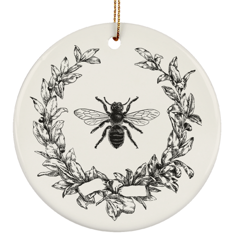 Vintage Style Olive Wreath And Honeybee Ceramic Ornament inspired by the French Empire's Napoleonic royal bee designs. It has a slight touch of the shabby chic nostalgia. It looks like something you may have found at one of the brocante stores in Paris. Perfect gift for art historians, honey lovers, beekeepers, entomologists, and everybody who cares about bees.