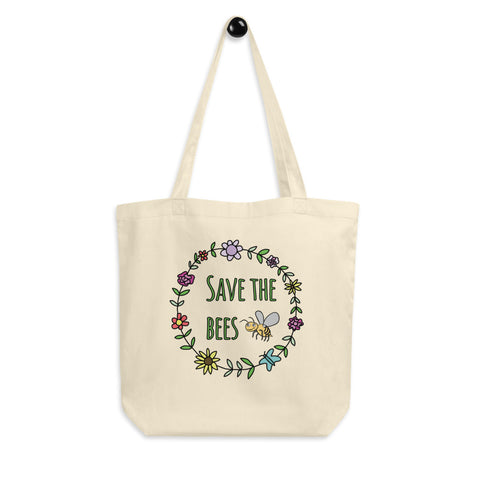 Save The Bees Flower Garland Reusable Eco Tote Bag. Ditch the plastic and save the bees! Jimmo Designs beautiful reusable shopping tote bag for nature lovers. It helps create awareness of the ecological tragedy that is currently happening in the world of bees. Help save the bees. Plant as many flowers in your backyard as only possible!