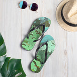 Tropical Dream Jungle Camouflage Print Flip-Flops. For some of us the Summer is never over. Designed especially for the discerning lovers of wild adventures, exotic vacation and tropical plants, these over print flip-flops featuring colorful tropical Monstera foliage camouflage pattern will make you stand out in the crowd on any beach.