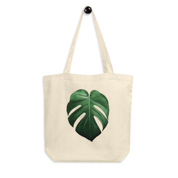 Ditch the plastic and grab this Monstera Deliciosa eco tote bag by Jimmo Designs! Great gift for gardeners, Monstera growers, botanical art collectors, and everybody who cares about the environment and loves tropical houseplants and gardening.
