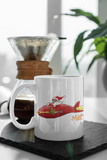 Jimmo Designs original Supersonic Santa Christmas Mug. Space Age nostalgia artwork! Beautifully designed Christmas mug for the whole family. Perfect gift for everybody who loves the fun, science fiction, humor, and beauty of the Holiday Season.
