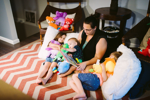 Mom Amanda Hanks reads to her three children, playing a game designed to improve children's emotional intelligence.