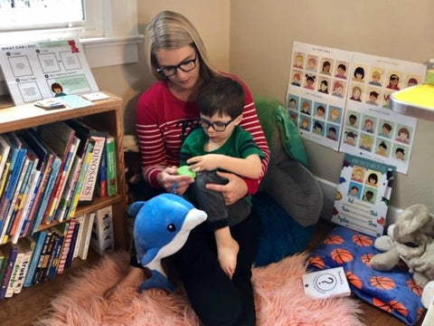 mom and son connecting in Calming Corner using Snugglebuddies Plush Toy