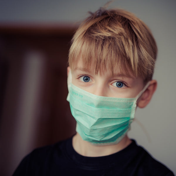 Child in a medical mask