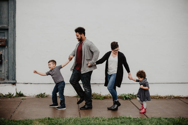 family of 4 walking