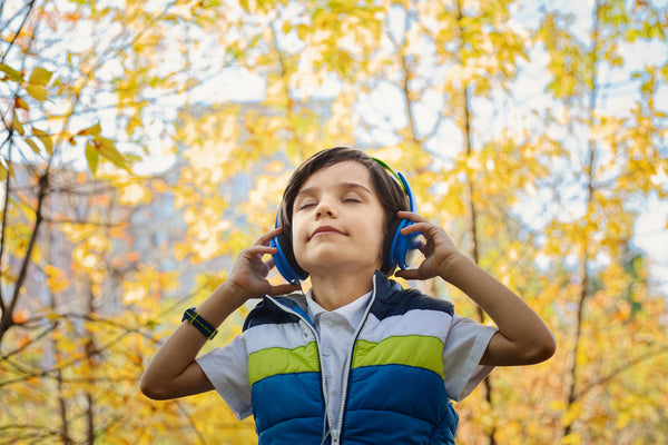 Boy outside listening to headphones