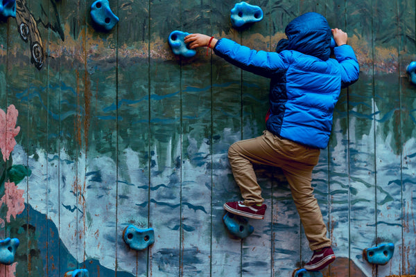 Boy rock climbing on the wall