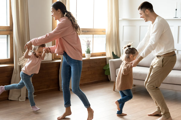 Family dancing to work through emotions