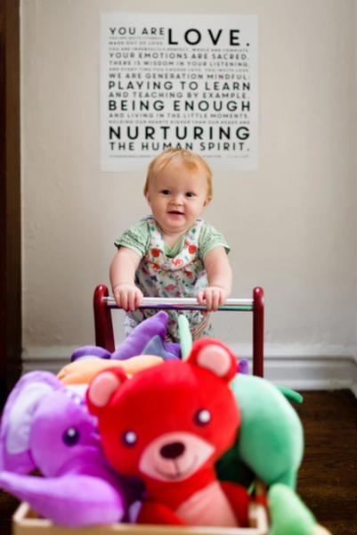 Ava (2) in her playroom displaying the Mindful Manifesto Poster