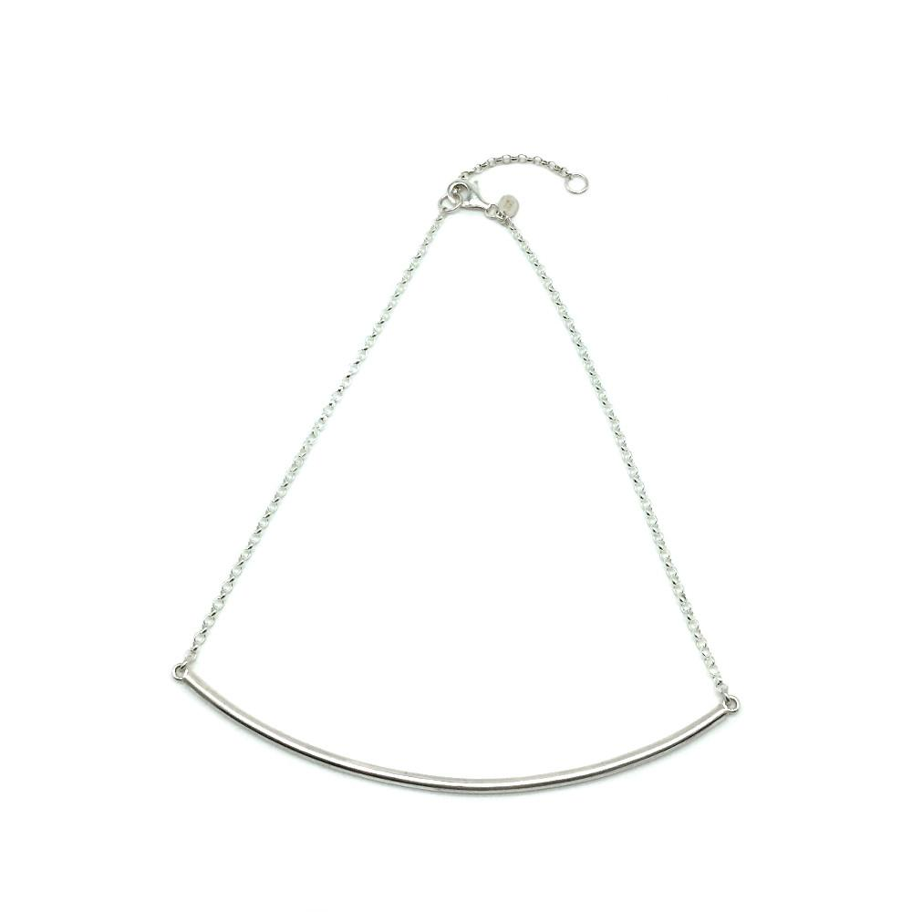 A loose fitting choker from Brash Bijoux. A solid silver curved bar is attached to chain. This is a standout piece that rocks!